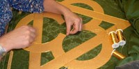 The renewal of a hand-appliqued Trinitarian symbol for an altar frontal orignally created in the mid-sixties